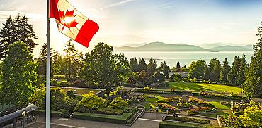 A Canadian flag flies above the Rose Garden at UBC Vancouver